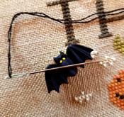 A Lit'l Batty Needle Nab-it